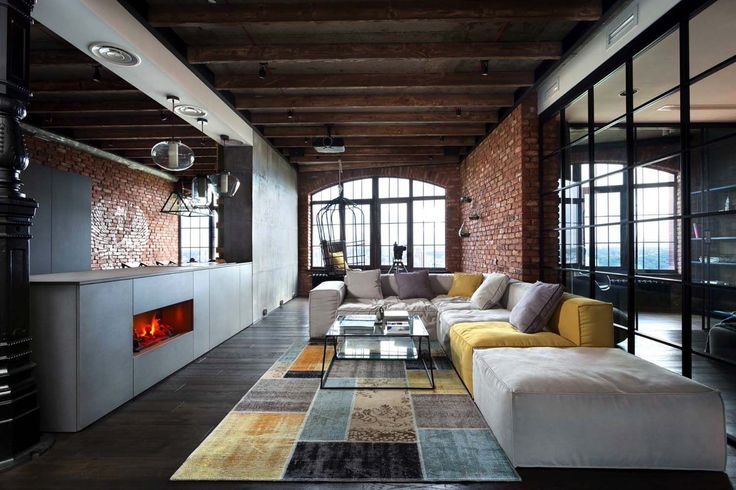 Industrial style loft in Kiev artfully blends drama and light