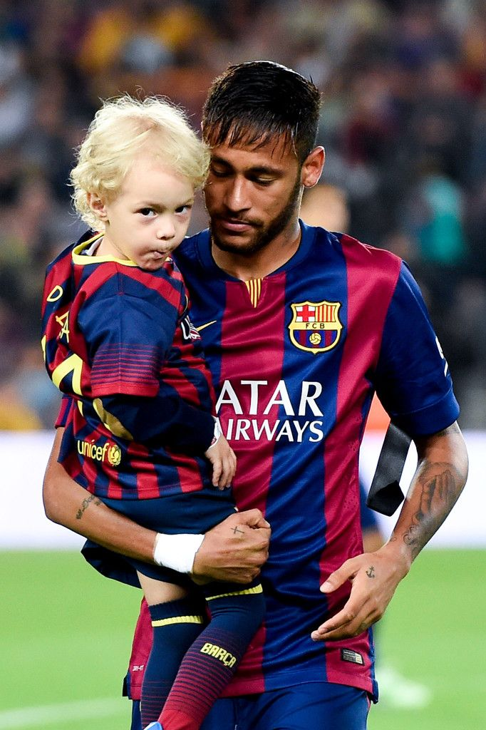 Neymar of FC Barcelona holds his son Davi Lucca during the La Liga match between FC Barcelona and Celta de Vigo at Camp Nou on November 1, 2014 in Barcelona, Catalonia.