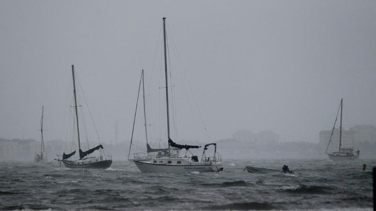 Boats sit in rough waters as rain from Tropical Storm Colin rolls in at Gulfport Beach in Gulfport, Fla., Monday, June 6, 2016. A large portion of Florida's western and Panhandle coast was already under a tropical storm warning when the National Hurricane Center announced that a swift-moving depression had become a named storm.