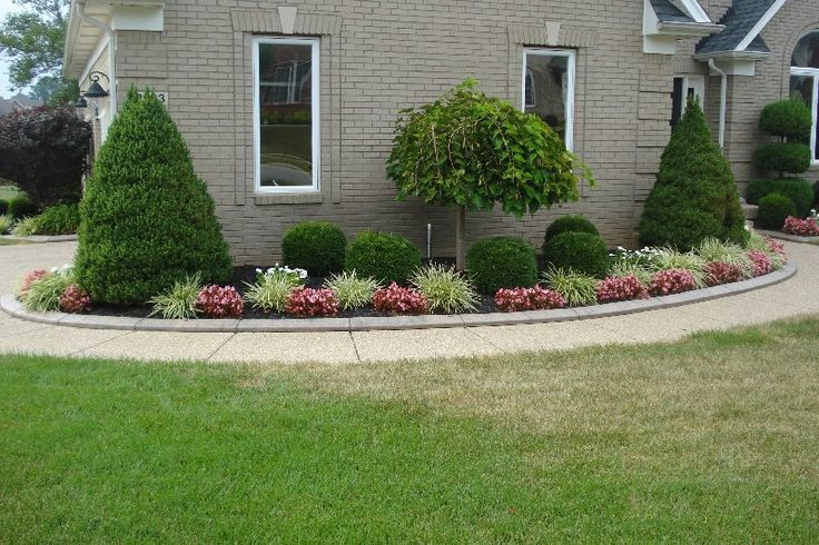 Curved sidewalk in front of side entry garage love it for Low bushes for landscaping