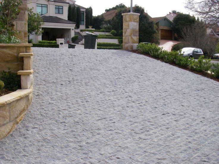 Eco Outdoor Buffalo granite split cobblestone driveway.