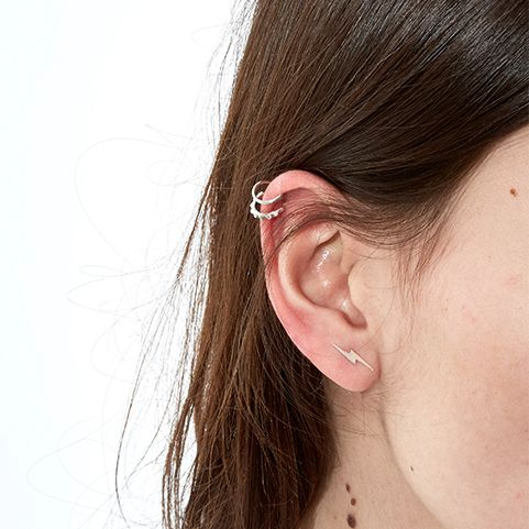 If you don't have your ears peirced then believe it or not many of the brands offer cuffs that simply clip onto the ear. Again multiple hoops on the smae ear is a good option keep them simple and short to avoid the classic Pat Butcher look.