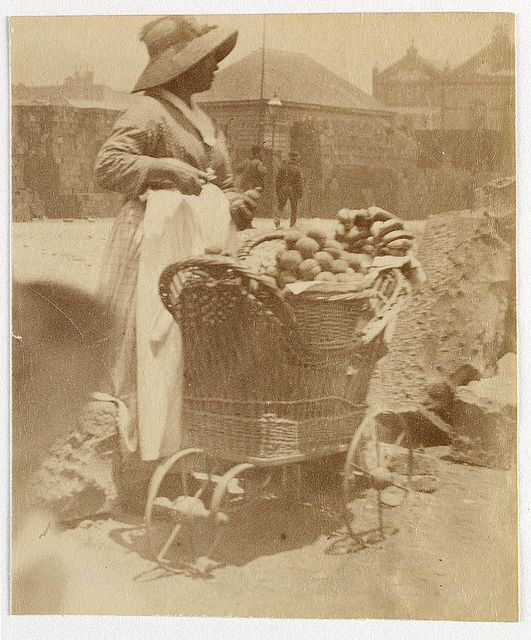 Woman selling fruit from small barrow Sydney, ca. 1885-1890 /photographed by Arthur K. Syer by State Library of New South Wales collection, via Flickr