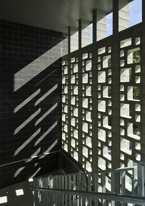 Concrete block turned on its side to form a stairwell wall that changes with the light...