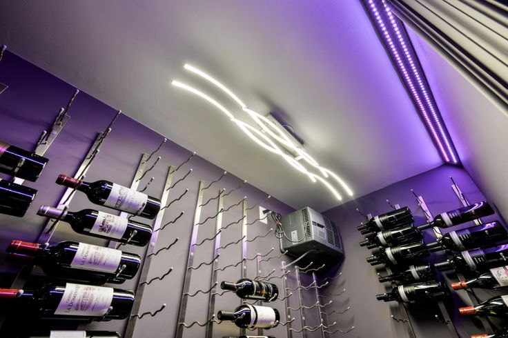 led chandelier in walk in wine cellar modern bar in basement