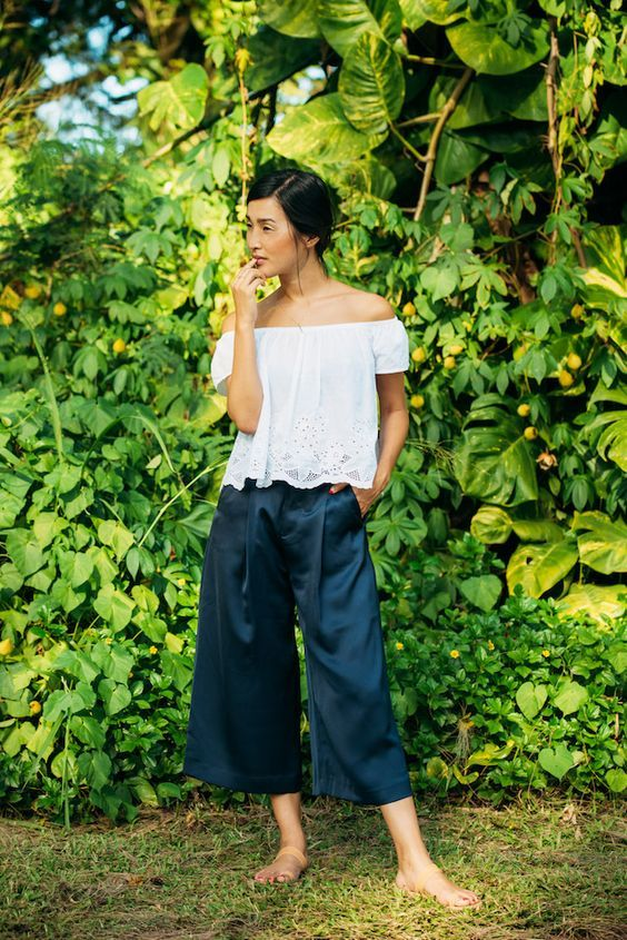 Stuck on how to wear culottes? Pair the cropped trouser with an off the shoulder blouse for a charming day look.