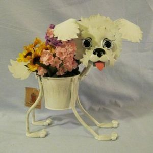 "Bichon Frise indoor or outdoors (garden) décor plant stands. Holds 4"" pots - 13"" inches tall by Georgetown Home & Garden. $32.25. minimal assembly, no tools required. 4"" diameter pot. made of durable metal. 13"" tall. marble eyes. This bichon frise planter stands alone and holds a 4"" diameter pot.  It is 13"" tall, made of durable metal, weather proof paint, with marble eyes.  Minimal assembly, no tools required."
