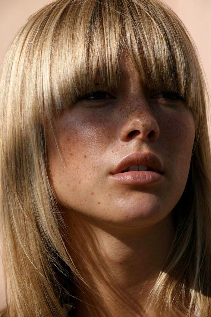 heavy blonde bangs + freckles