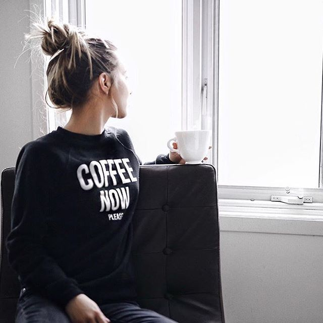 Karolina Jez wearing our Coffee Now Please sweater in black.