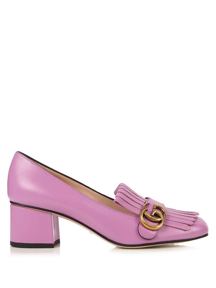 Gucci's must-have Marmont loafers come in pretty bubblegum-pink leather for AW16. The fringed front and antiqued gold-tone metal GG plaque bring a dose of vintage charm, while the sturdy block heel is ideal for striding through the city. Wear them with any of the label's precious, eclectic pieces – think a knife-pleated skirt by day, and a Victoriana-inspired dress come evening.