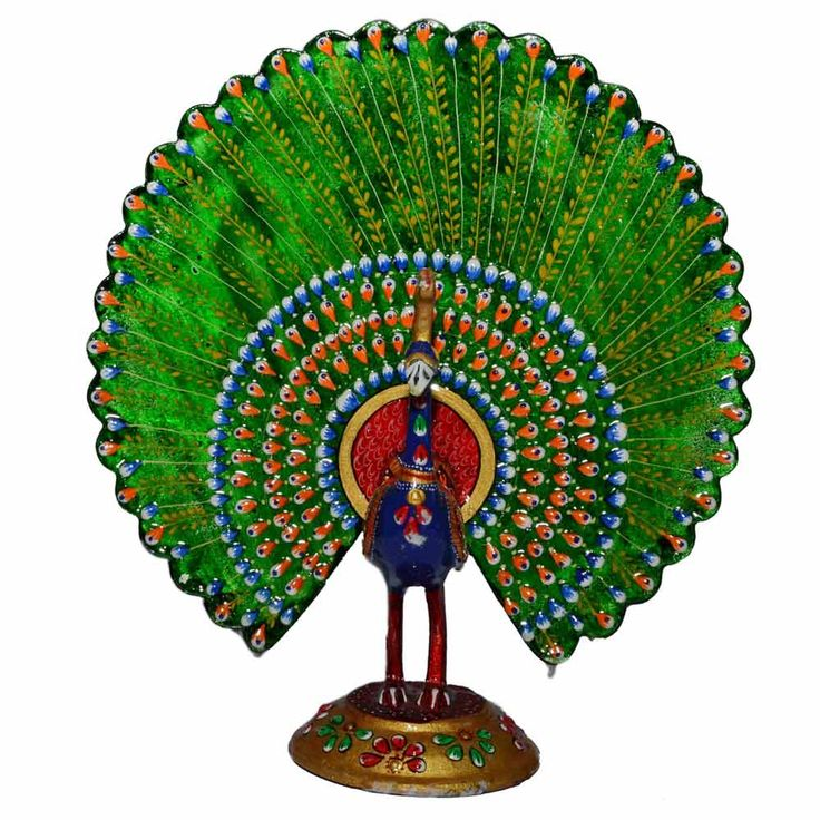 This exotic masterpiece beautifully carved from metal is all set to stylize your home uniquely.        Associated with romantic love and religion in Indian iconography, peacocks are the epitome of beauty and ecstasy, and the purest of all living beings by birth in Hindu mythology. The dancing peacock is as elegant as a ballet dancer, sensual and exotic, telling a story of romance, attraction and allure. Click here to buy this product - www.kalakhoj.com