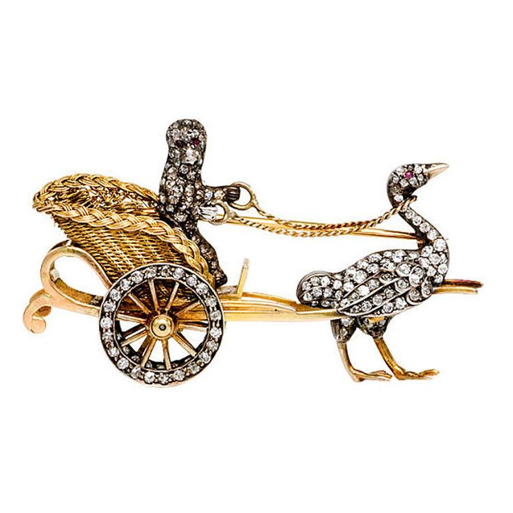 Antique Gold and Diamond Brooch of a Monkey and an Ostrich. Circa 1880.   An antique gold and diamond brooch, designed as an ostrich-drawn carriage with a monkey at the reins, in 18k.