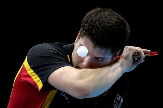 Dimitrij Ovtcharov of Germany competes against Peng Tang of Hong Kong during the Men's Team Table Tennis bronze medal match on Day 12 of the London 2012 Olympic Games at ExCeL on August 8, 2012