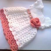Cute baby dress with crochet flower - via @Craftsy