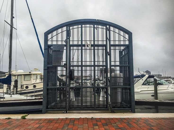 #bmoreadoorable Dockside  _______________________________________________ #pier #dock #waterfront #boat #boats #sailboat #water #bay #harbor #fellspoint #canton #baltimore #bmore #charmcity #discovercharmcity #thebmorecreatives #travel #explore #door #doors #gate #entrance #overcast #outdoors #sail #chesapeakebay #innerharbor by bmore_adoorable