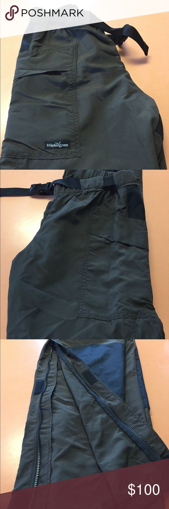 """Wintergreen Northern wear shell pants NWOT Wintergreen Northern wear shell pants. Handmade in Ely, MN   They are khaki green with black enforced knees and seat. Side zip and Velcro for easy on/off over your boots. The pants sell for over $200 (see their website). I purchased these in November and have never worn them.  I decided to go with a different system but I am past the return timeline. I will list them for half price. 30"""" inseam and 27"""" elastic waist. Wintergreen Northern Wear Pants"""