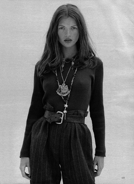sweater, belted trousers, ethnic jewelry
