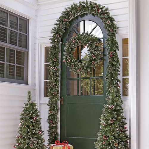 Decorate your front door a door is one of the first things Outdoor christmas garland ideas