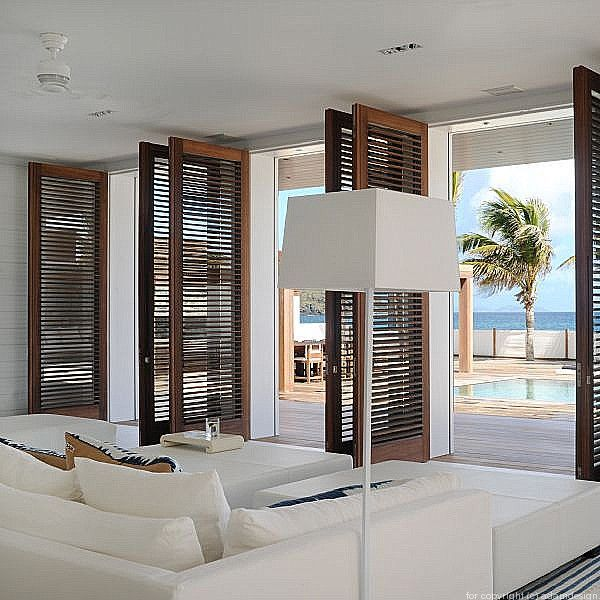 Dark wood shutters compliment this white room with a spectacular view! We can help achieve this look in your home - www.budgetblinds.com/southorlando