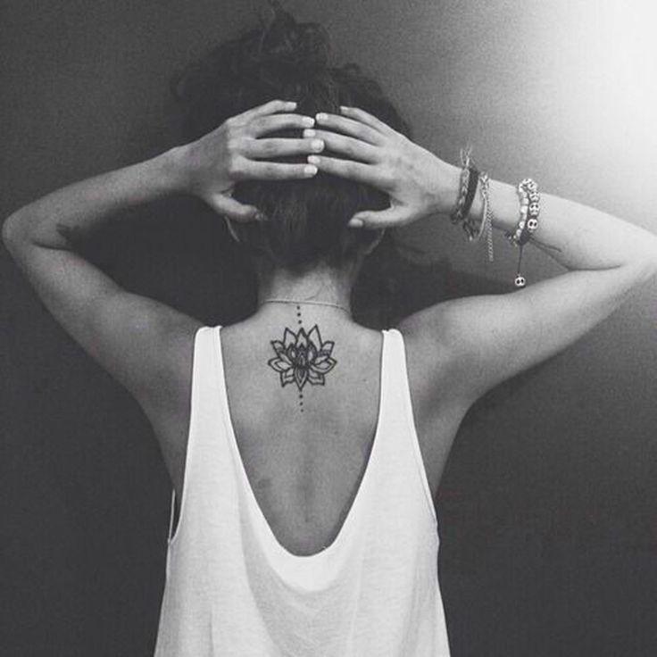 Lotus Flower Vertical Upper Back Spine Back Tattoo Placement Ideas at MyBodiArt.com