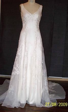 New With Tags Reva Mivasagar Wedding Dress Size 8  | Get a designer gown for (much!) less on PreOwnedWeddingDresses.com