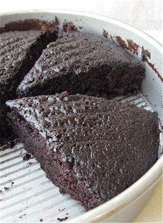 """This """"cake pan"""" cake was invented during the WWII era when times were scrace, and uses no milk, eggs, or butter, making it accidentally vegan! It's mixed in the same pan you bake it in."""