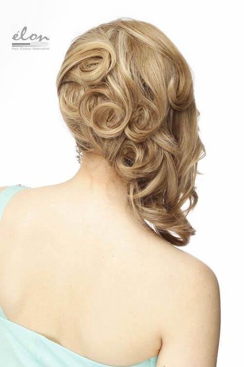 Perfectly sculpted upstyle for mid-length hair
