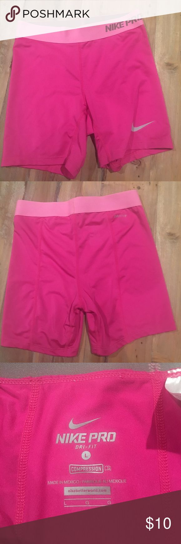 Nike Pro Dri-Fit Compression Shorts Girls stretch Nike compression shorts. Excellent used condition. No stains or snags. Color is hot pink with lighter pink waistband. Nike Bottoms Shorts