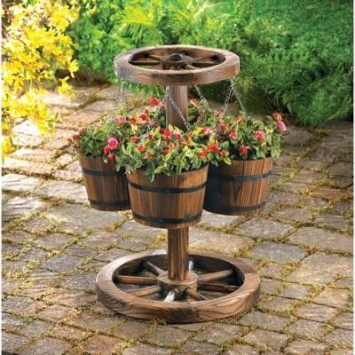 Wagon Wheel Planter. This rustic planter lends its country charm to any setting with its well weathered, antique look. It also helps you get some height or depth to your yard or patio. Four wooden buckets hold your favorite plants, hanging from a realistic wagon wheel.