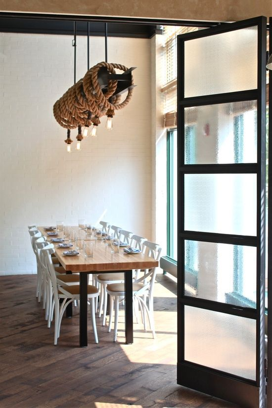 Dining Room With Glass Doors And A Nautical Rope Chandelier