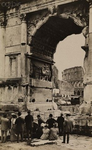 People admire the Arch of Titus, it spans Sacra Via's highest point - 1922…