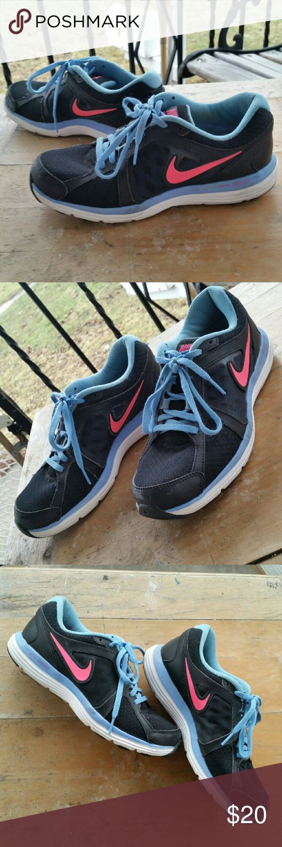 Nike Dual Fusion ST3 Sneakers Nike Dual Fusion ST3 shoes.  Black with hot pink & blue accents.  Cute and comfortable for working out & running!  In great condition, please zoom in and note minor scuffs and other normal signs of use. US Women's Size 8 Nike Shoes Athletic Shoes
