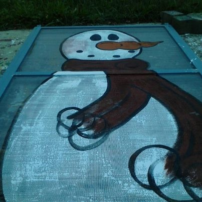 old window screen painted with snowman-recycle, upcycle, reuse, rethink, repurpose www.goldncountrygifts.com & https://www.facebook.com/weluv2cre8