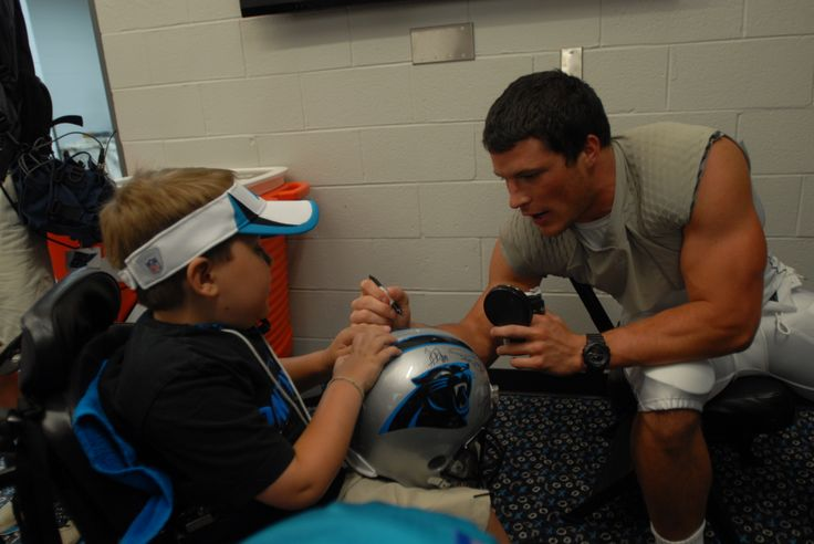 Honorary Coach Jack Bolton gets an autograph from Luke Kuechly