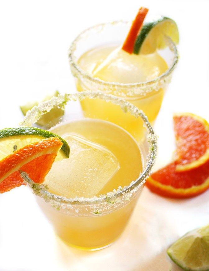 Skinny Orange Lime Margarita - THE BEST MARGARITAS! They are made with fresh ingredients, is naturally sweetened with agave nectar, and is EASY to make. They are rimmed with a salt/sugar/lime mixture which pulls everything together. Vegan/Gluten Free | robustrecipes.com