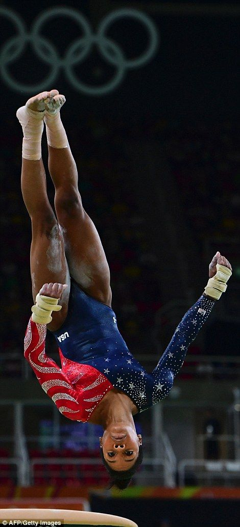 US gymnast Gabrielle Douglas competes in the qualifying for the women's floor event of the...