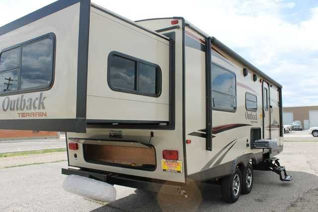 2016 New Keystone Outback Terrain 230TRS Toy Hauler in Wyoming WY.Recreational Vehicle, rv, 2016 Outback Terrain 230TRS 2016 KEYSTONE OUTBACK TERRAIN 230TRS Terrain is a full sized ultra-lite that delivers lots of space without the weight. Affordable and comfortable the Terrain comes standard with 32 inch TV's, vaulted ceilings and a large amount of storage. A full colored exterior nicely complimented with a molded fiberglass front cap sets the Terrain apart.