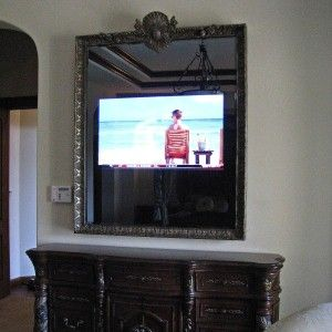 46 inch Samsung LED Television Mirror with custom Mediterranean frame and beveled glass over dresser