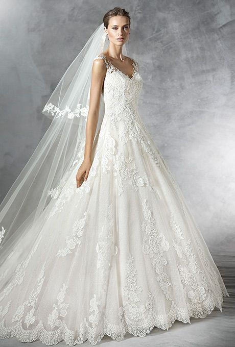 Brides: Pronovias. A-line dress, in tulle with lace and guipure appliqués. V-neckline with sheer overlay decorated with appliqués front and back.