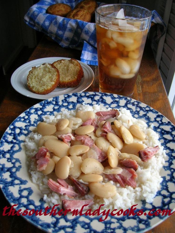 LIMA BEANS WITH HAM OVER RICE.....this is old school southern eating.  How many nights did my grandma fix this for my grandfather's dinner?  Just seeing the picture takes me back to my childhood...  One note....this dish is best served fresh!  It can be gently reheated....but it tastes better fresh!  Don't make a huge pot to have several meals....Lima beans aren't like other beans.
