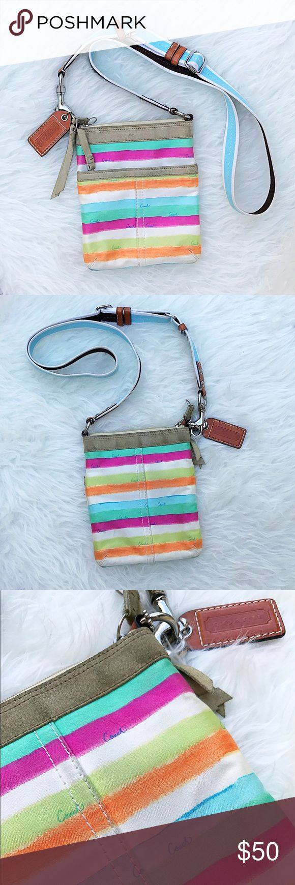 Coach Swingpack No. M0751-F10718- Watercolor Coach Crossbody Swingpack No. M0751-F10718- Watercolor. This bag features cotton multi colored stripes with 'Coach' Print (COLORS: GREEN, ORANGE, PINK, LIGHT BLUE, LEMON, WHITE). This bag features a Canvas body, Blue/White adjustable strap with silver hardware and Brown Leather Accents, Front Zip Pocket with Suede pull strap, Zip top closure, Camel suede trim, Blue satin interior lining, white leather creed, and Brown Leather Logo Tag…