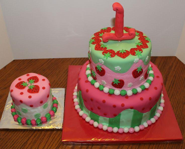 """Strawberry Shortcake 1st birthday cake and smash cake. Strawberry and white cake. Buttercream with marshmallow fondant doecorations. Gumpaste """"1""""."""