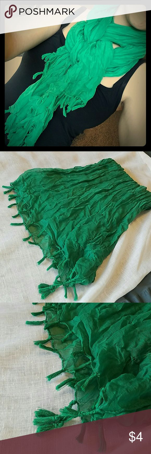 Kelly Green Lightweight Crinkle Scarf Soft lightweight crinkle like scarf in a great green. Worn on St Paddys! Tassle bottoms are in perfect condition. Bundle and Save 20%! Or add to a bundle and offer to possibly receive for free! Clearing out my collection! Accessories Scarves & Wraps