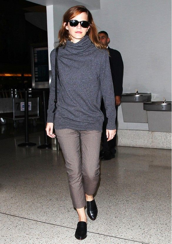 Emma Watson goes cozy in a grey soft turtleneck  and black flats.