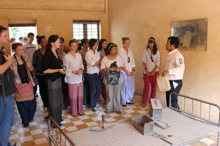 A school group touring Tuol Sleng Genocide Museum. Inside a torture cell.