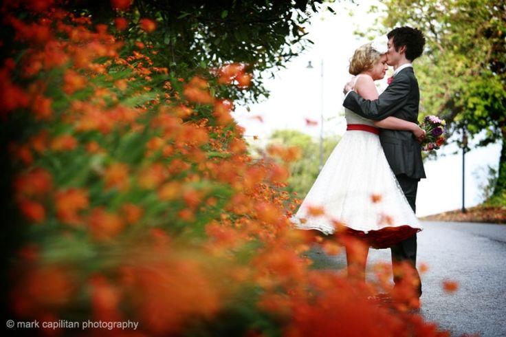 Bride & groom & montbrecia flowers in Castle Dargan Ireland wedding photographer Sligo