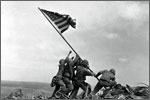1945: Joe Rosenthal, The Associated Press.  Marines Raise the Flag on Iwo Jima.  Associated Press photographer Joe Rosenthal (1911-2006) took this photograph of U.S. Marines raising the flag on Iwo Jima during World War II. Rosenthal won the 1945 Pulitzer Prize for photography.