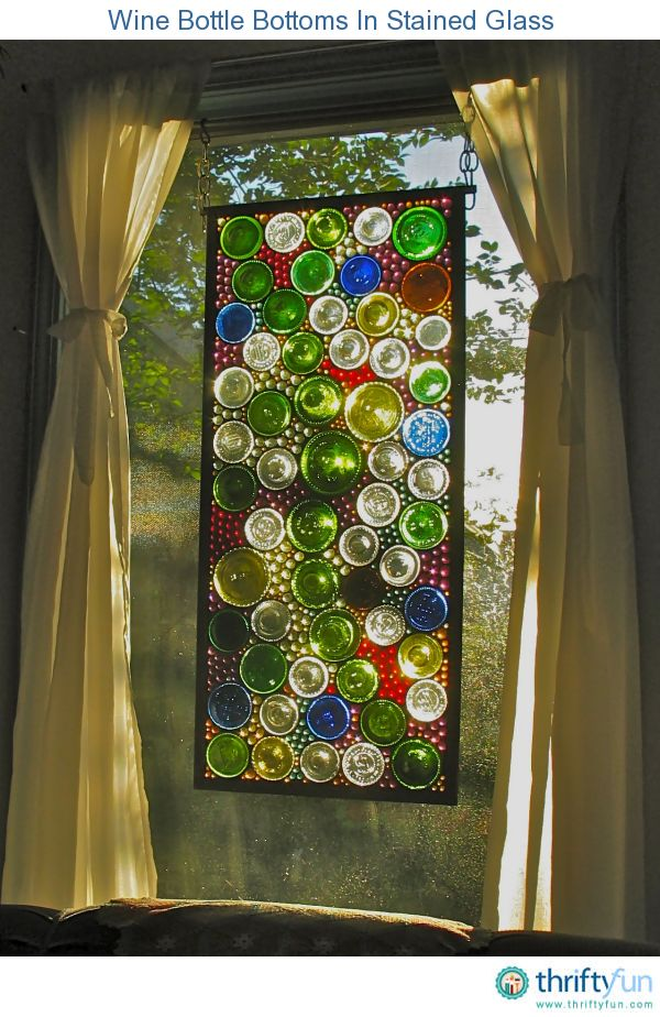 A stained glass window using cut wine bottle bottoms. Cool idea.