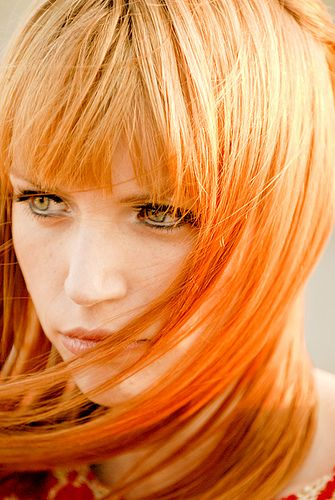 Long straight light red hair with bangs and red orange Electric Tiger Lily (manic panic) colored ends hairstyle