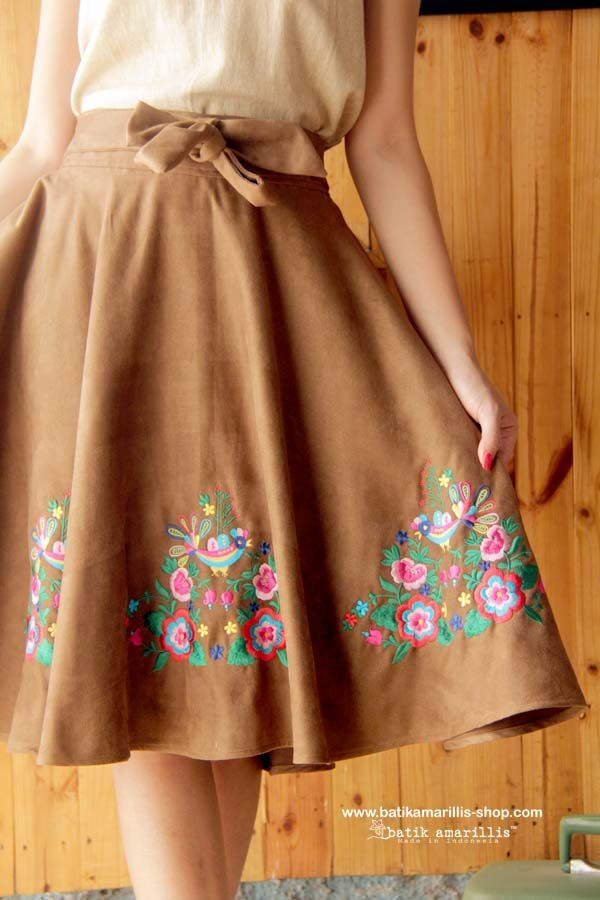 batik amarillis's amarillissima blooming skirt-This fabulous and luxurious Hungarian embroidery on faux suede skirt features a structured waistband with sash which can be styled front or back ,the skirt merging down into a billowing pleated skirt. this beautifully tailored garment will turn heads with its captivating design